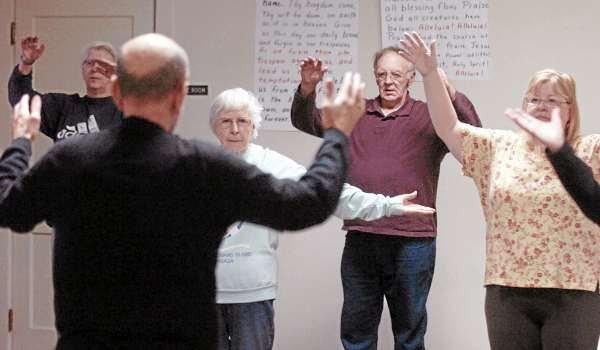 People watch Bruce Young (left) the instructor in the Tai Chi class at the United Methodist Church in Bangor Friday morning. (Bangor Daily News/Gabor Degre)