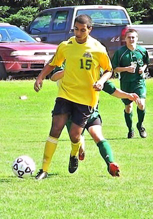 CUT LINE, AMINE: Amine El Moumen, 18, a freshman at UMFK, makes his way towards  the goal during a soccer match at the University of Maine at Fort Kent in early  fall. El Moumen, who lives in Canada, was one of the team?s leading scorers and  said that he enjoyed his first year as a college player. (CONTRIBUTED PHOTO)