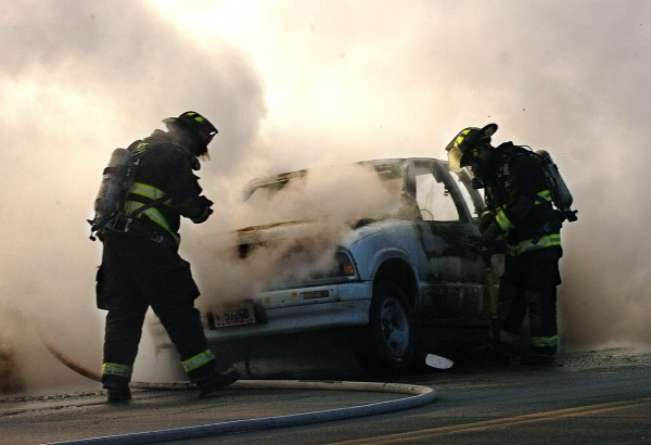 Orono firefighters extinguish a car fire on the off-ramp of Exit 193 of 95 North on Tuesday, January 4, 2011. The 1997 Chevrolet pick-up was being driven by its owner, Mark Calcia of Sorrento, who escaped without injury. &quotI just heard a big boom and then fire started pouring out,&quot said Calcia. (Bangor Daily News/Kate Collins)