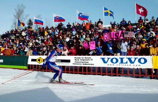 Russell Currier of Stockholm is cheered on by a large crowd Sunday during the men's pursuit competition at the Biathlon Junior World Championships at the Nordic Heritage Ski Center in Presque Isle. (BANGOR DAILY NEWS PHOTO BY BRIDGET BROWN)