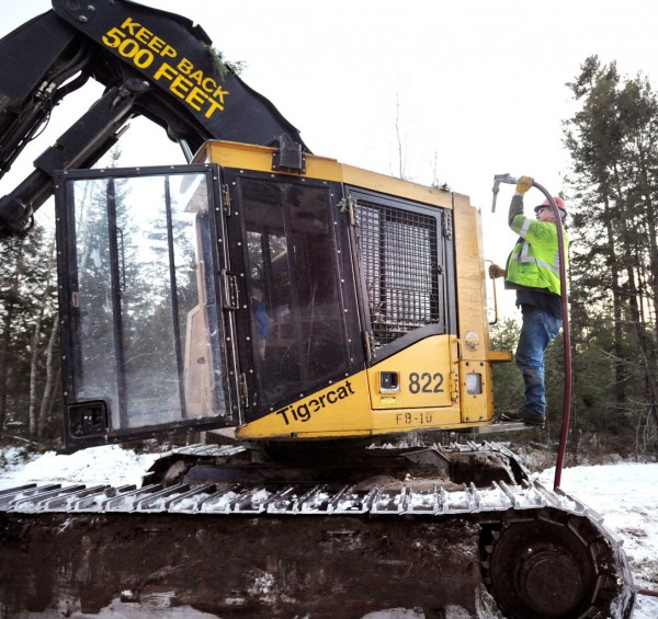 W. T. Gardner Logging Co. feller buncher operator Gary Martin refuels a the machine at the end of the day s in Chester Tuesday afternoon.   (Bangor Daily News/Gabor Degre)