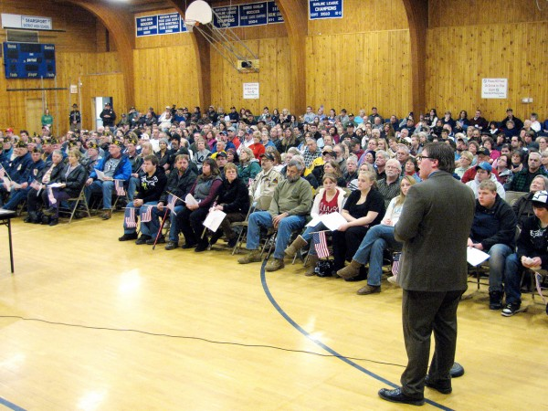 High school student Zach Parker presents his legislation on banning protests at military funerals to a crowd of hundreds who packed the Searsport District Middle School gym on Wednesday, January 5, 2010. Parker's proposal has won him some national attention, with an appearance last week on the Fox & Friends morning program. He'll be featured on that program again on Thursday, January 6, he said. (Bangor Daily News/Abigail Curtis)