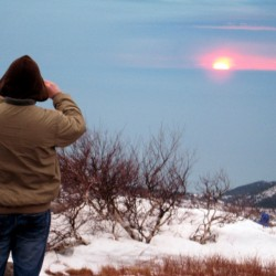 An unidentified hiker on the summit of Cadillac Mountain captures a picture of the sunrise on New Year's Day. Brad Viles photo