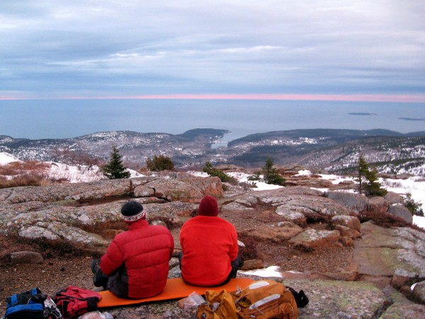 A couple of hikers wait for the sunrise on New Year's Day on the summit of Cadillac Mountain. Brad Viles photo