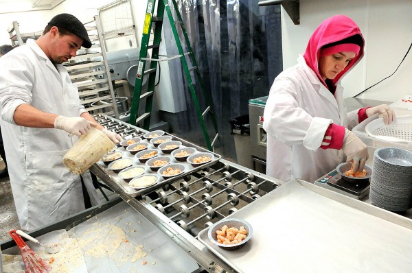 Michael Hannah, left, of Pembroke helps co-worker Misty Moores (cq) of Lubec prepare Maine Fresh Maine shrimp pies at the Cobscook Bay Company's production facility at Phinney Fisheries in Trescott, Maine January 6, 2011. So far, they offer a Maine crab pie, Maine shrimp pie, Maine scallop pie and a Maine lobster pie. (Bangor Daily News/John Clarke Russ)