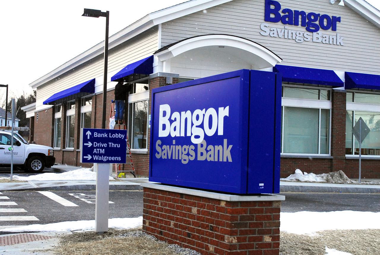Ryan Landry of Landry/French Construction of Scarborough finishes off some detail work on the new Bangor Savings Bank branch in Portland on Allen Avenue in January 2011.
