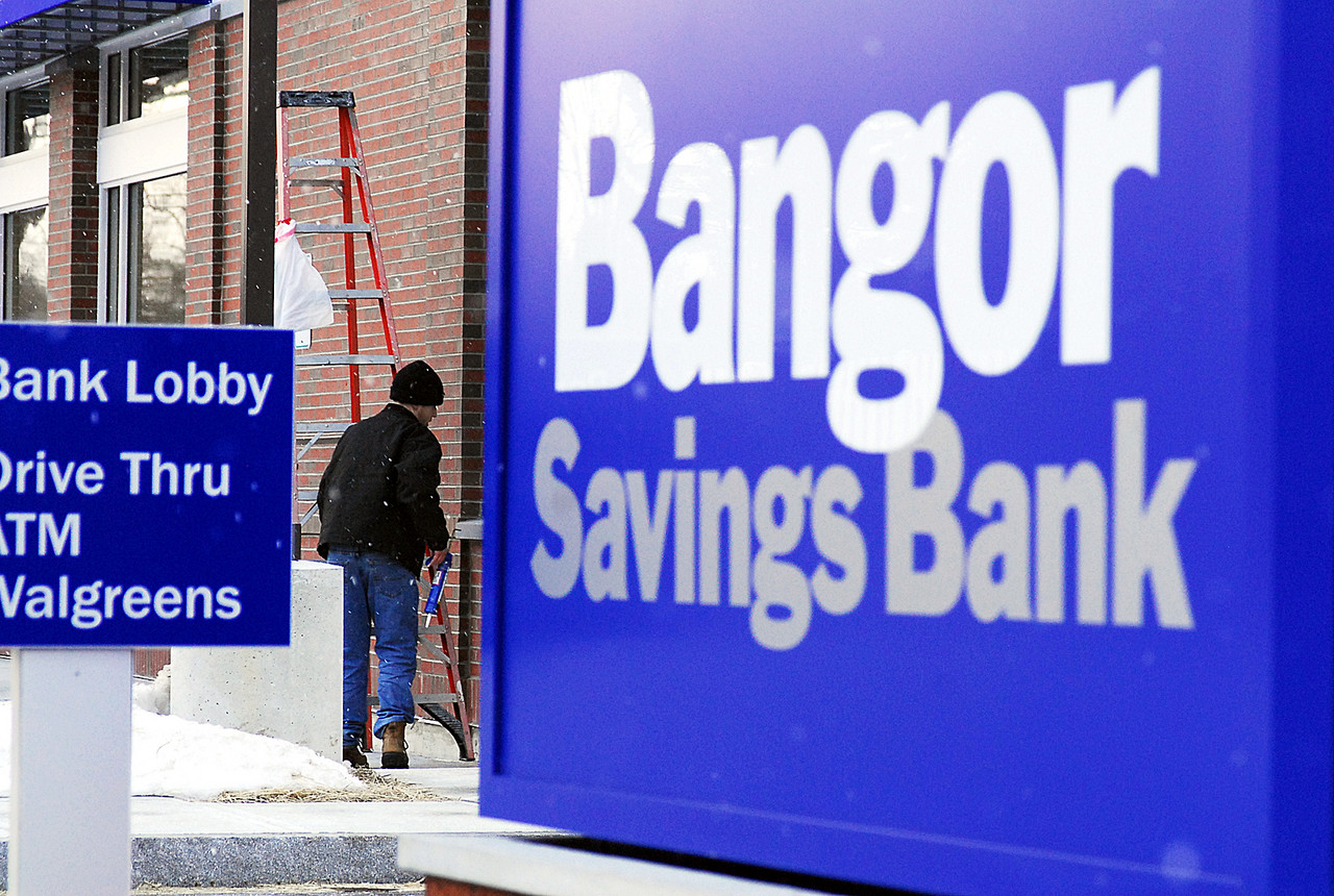 Ryan Landry of Landry/French Construction of Scarborough finishes off some detail work on the new Bangor Savings Bank branch in Portland on Allen Avenue. The branch is set to open Monday, and is part of the bank's $4 million expansion into the Portland-area market. (Bangor Daily News/Matt Wickenheiser)