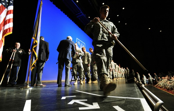 Members of the Bravo Company, 3rd Battalion-172nd Mountain Infantry unit line up on the stage of the Collins Center for the Arts on Friday, January 7, 2011 to receive walking sticks  from Galen Cole, third from left, during the Maine Army National Guard's Freedon Salute. BDN Photo by Kevin Bennett