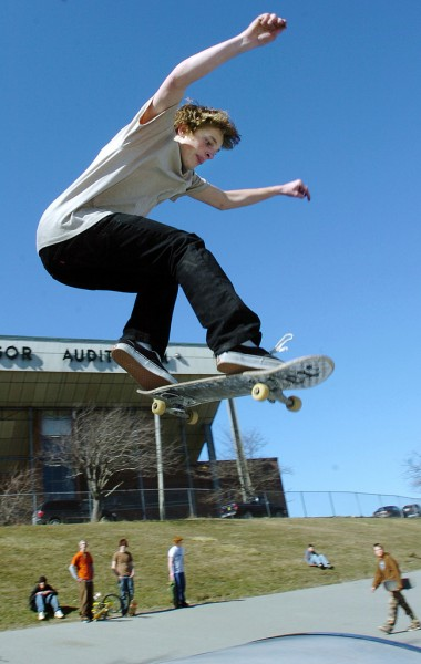 LIGHT AS A FEATHER, STIFF AS A BOARD   Danny McFarland of Ellsworth gets some air Saturday off one of the new ramps installed at the Bangor Skate Park in front of the Bangor Auditorium. Some skaters say the new ramps could be better constructed. The materials and labor to make the ramps were donated by MacMillan Excavation of Bangor.  (BANGOR DAILY NEWS PHOTO BY KEVIN BENNETT)