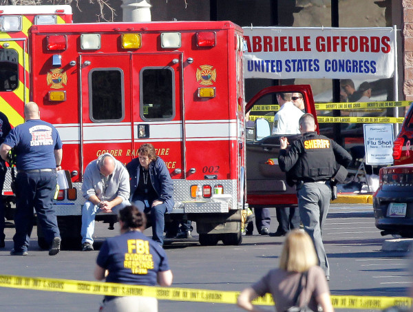 Emergency personnel work at the scene where Rep. Gabrielle Giffords, D-Ariz., and others were shot outside a Safeway grocery store in Tucson, Ariz. on Saturday, Jan. 8, 2011. (AP Photo/Matt York)