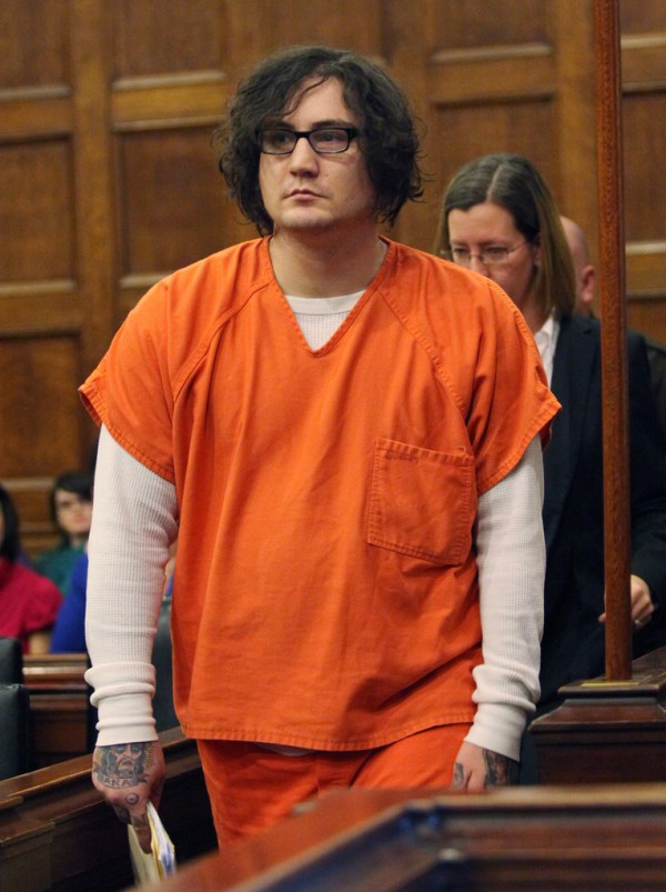 Chad Gurney walks into court Monday, Jan. 10, 2011 in Portland, Maine for his trial on charges of strangling his girlfriend 18-year-old Zoe Sarnacki then cutting off her head and setting her body on fire. Prosecutors are saying a 29-year-old Portland man was not insane when he strangled his girlfriend, cut off her head and set her body on fire nearly two years. But defense attorney Sarah Churchill told a judge during Monday's opening statements that Chad Gurney was suffering from a mental disease or defect that prevented from appreciating the wrongfulness of his actions. (AP Photo/Joel Page)