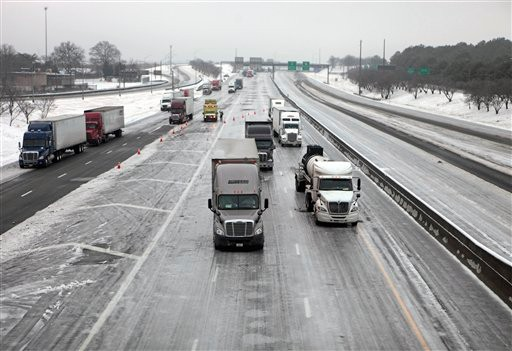 Trucks sits stranded, some for over 24 hours, on Interstate 285  in Atlanta from a winter storm that turned the road into a sheet of ice Tuesday, Jan. 11, 2011. (AP Photo/David Goldman)