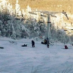 **  CAPTION CORRECTION, CORRECTS TO SUGARLOAF BEING  THE STATE'S SECOND TALLEST MOUNTAIN AND TALLEST SKI MOUNTAIN ** This photo provided by Al Noyes shows skiers and lift chairs on the slope after a lift derailed on the state's tallest ski mountain and second tallest mountain overall at the Sugarloaf resort in Carrabassett Valley, Maine, Tuesday, Dec. 28, 2010. (AP Photo/Al Noyes)  NO SALES