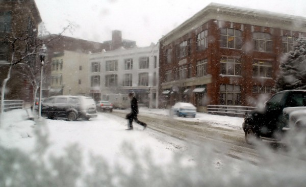 (BANGOR DAILY NEWS PHOTO BY LINDA COAN O'KRESIK)  CAPTION  BANGOR, ME -- JANUARY 12, 2011 -- A pedestrian runs across Central Street in downtown Bangor during the snow storm that brought blizzard conditions on Wednesday January 12, 2011. Bangor Daily News/Linda Coan O'Kresik