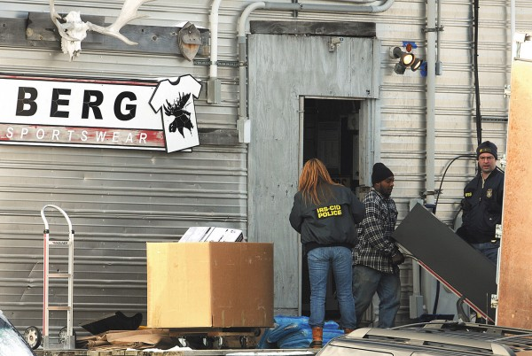 Federal Agents watch as filing cabinets are loaded into a moving truck at Berg Sportswear in Corinna on Thursday, January 13, 2011.