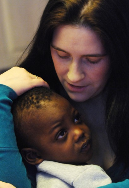 Amanda Logiodice of Pittsfield cuddles with her adpoted son J.J. of Haiti at the familys home in Pittsfield on Thursday, January 13, 2011. The two year old, formerly known as David, came to America with medical problems but is now a healthy toddler who is slowly learning to talk. BDN Photo by Kevin Bennett