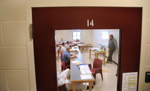 Inmates listen to Patrick Mundy (right) during a history class at the Maine State Prison in December 2010. About 40 students are enrolled in the prison college program at the Warren facility that allows them to earn a college degree while behind bars.  The program is fully payed for by the Doris Buffett's Sunshine Lady Foundation but the prison also cooperates with the University of Southern Maine to make the program possible. (Bangor Daily News/Gabor Degre)