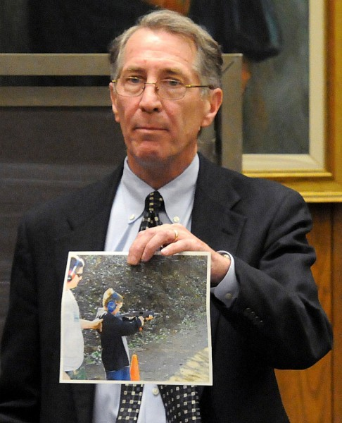 Prosecutor William Bennett shows the jury Thursday, Jan. 6, 2011, in Hampden Superior Court in Springfield, Mass., a photo of Colin Bizilj, 11, brother of victim Christopher Bizilj, firing a machine gun at a gun show in Westfield, Mass., in October 2008. The evidence was presented in the manslaughter trial of former Pelham, Mass. Police Chief Edward Fleury, whose company co-sponsored the gun fair. (AP Photo/Springfield Republican, Michael S. Gordon)