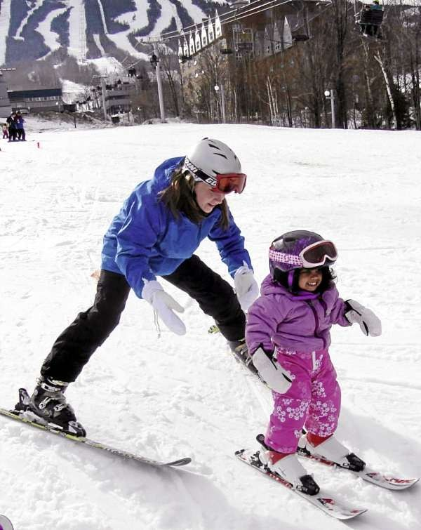 Michelle Porter, 13, of Lincoln, teaches her cousin Lea Harmon, 3, of Hampden how to ski at Sugarloaf the first weekend of this month. Both Michelle and Lea are &quotWinterKids.&quot They use the WinterKids FunPass and Passport provided by the nonprofit, Portland-based organization Winterkids to visit outdoor recreational centers at free or discounted rates. (BDN Photo by Aislinn Sarnacki)