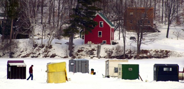 A man walks to his fishing shack Monday on  Bryant Pond in Woodstock. (AP Photo by Robert F. Bukaty)