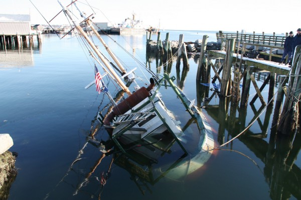 A boat sank at the Rockland Fishing Pier and was leaking fuel when the Rockland Fire Department arrived on the scene about 9:20 a.m. Saturday, Jan. 15, 2011. The fire department assisted the Coast Guard with the placement of an oil containment  boom around the boat, according to a press release from the fire department.  Photo Courtesy of Rockland Fire Department