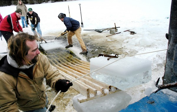 Volunteers work together to load 400-pound blocks of ice harvested from Little Black Lake Saturday (Jan. 15, 2011) for use as the building blocks of the Chateaux du Festival during World Cup biathlon in Fort Kent next month.