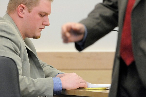 Defendant David Churchill, 26, of Fort Fairfield looked over notes as his defense attorney, Hunter Tzovarras, right, approached the jury box for his opening arguments in Churchill's trial at Penobscot County Judicial Center Tuesday, Jan. 18, 2011. Churchill is charged with sexually assaulting his ex-girlfriend's 12-year-old daughter in the summer of 2009. (Bangor Daily News/John Clarke Russ)