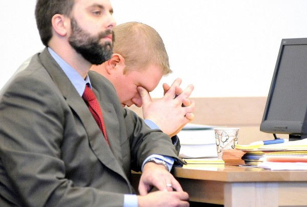 Seated next to his defense attorney Hunter Tzovarras, David Churchill, 26, of Fort Fairfield reacted as Penobscot County Deputy District Attorney Michael Roberts described the allegations against him during opening arguments in Churchill's trial at Penobscot County Judicial Center Tuesday, Jan. 18, 2011. Churchill is charged with sexually assaulting his ex-girlfriend's 12-year-old daughter in the summer of 2009. (Bangor Daily News/John Clarke Russ)