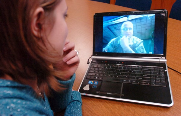 Elizabeth Tilton of Bangor uses Skype to talk with her husband, Spc. Josh Tilton, on Tuesday, January 18, 2011. Spc. Tilton is currently stationed in Kabul, Afghanistan, but Skype helps the couple to stay in close communication during his deployment. (BDN Photo by Kate Collins)