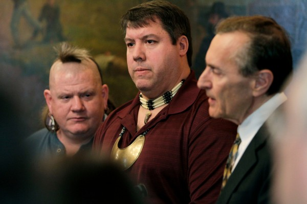 Chief Don Stevens, of the Nulhegan Band of the Coosuk Abenaki Nation, center, and Chief Roger Longtoe Sheehan, of the Elnu Abenaki, left,  listen to Sen. Vince Illuzzi, R-Essex-Orleans, on Wednesday, Jan. 19, 2011, in Montpelier, Vt. A panel organized to set up a process for state recognition of Indian tribes in Vermont is asking the Legislature to recognize two Abenaki tribes. The Vermont Commission on Native American Affairs is recommending that the Nulhegan Band of the Coosuk Abenaki Nation, based in Brownington, and the Elnu Abenaki in the southeast, be recognized. (AP Photo/Toby Talbot)