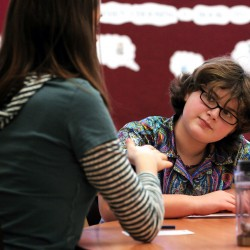 Kalie Hess, left, a University of Maine student, plays a board game with her mentoree, Old Town Elementary School student Abby Montieth, right, on Wednesday, January 19, 2011. Old Town Elementary School's mentoring program is aimed at promoting self esteem, motivation and help with homework for the students. The university students' work is part of their community service. BDN Photo by Kevin Bennett