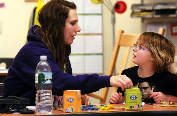 University of Maine student Kelli Gile, left, plays a board game with her mentoree, Old Town Elementary student Keaton Michael, right, on Wednesday, January 19, 2011. Old Town Elementary School's mentoring program is aimed at promoting self esteem, motivation and help with homework for the students. The university students' work is part of their community service. BDN Photo by Kevin Bennett