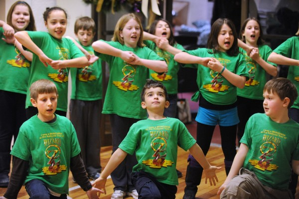 Children during the rehearsal of the Wizard of Oz at the Penobscot Theater in Bangor.  The touring company that will put on the show on January 24th at the Collins Center for the Arts recruited 12 children from the area to perform as the munchkins in the show. BDN photo by Gabor Degre