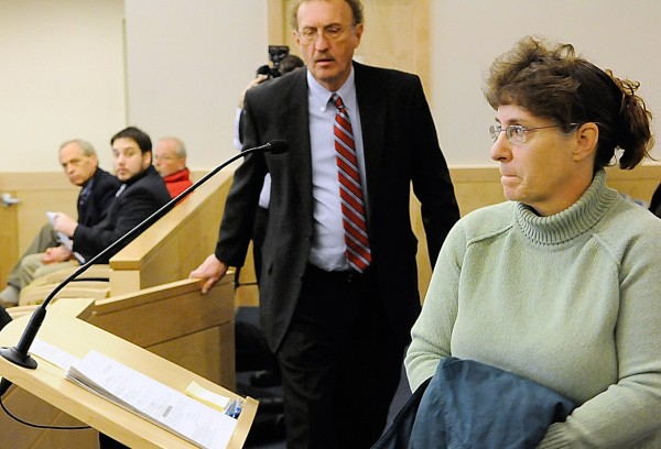 Cindy Dunton and her attorney Dale Thistle approach the lectern as they get ready to address Superior Court Justice Kirk Studstrup (not pictured) during her arraignment at Penobscot Judical Center Thursday, Jan. 20. 2011. Dunton, the former deputy treasurer  and clerk for the Town of Newburgh,  is accused of embezzling nearly $200,000 in Newburgh taxpayer funds. (Bangor Daily News/John Clarke Russ)
