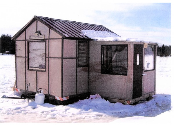 This is the Ice Castle Inn, owned and operated by Alveine Laliberte and built by her husband, Alphonse Laliberte. The inn features a storage shed and mud room, both of which are portable by skis and wheels.