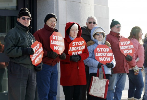 Participants in an annual anti-abortion rally gather outside of the state house Saturday, Jan. 15, 2011 in Augusta, Maine for the &quotHands Around the Capitol&quot rally. The rally is held each year to recognize and mourn the anniversary of the Supreme Court's Roe vs. Wade decision.