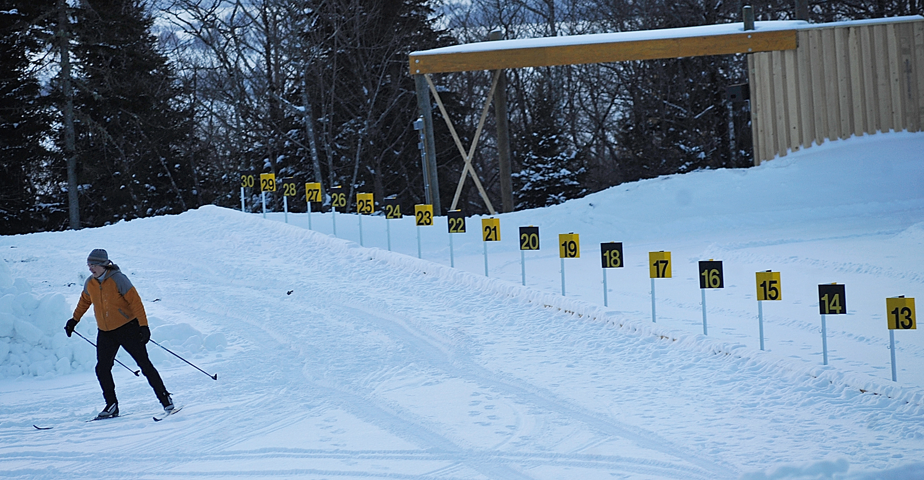 Biathlon volunteer Michelle Anderson of Presque Isle gets in a few laps in the soon-to-be-groomed penalty lap area and shooting range at the Nordic Heritage Center  in Presque Isle just before sunset Wednesday, Jan. 26, 2011. The World Cup Biathlon tour is coming to Presque Isle February 4-6 and to Fort Kent February 10-13 and area businesses, many of which are working and volunteering at both venues, expect to benefit.