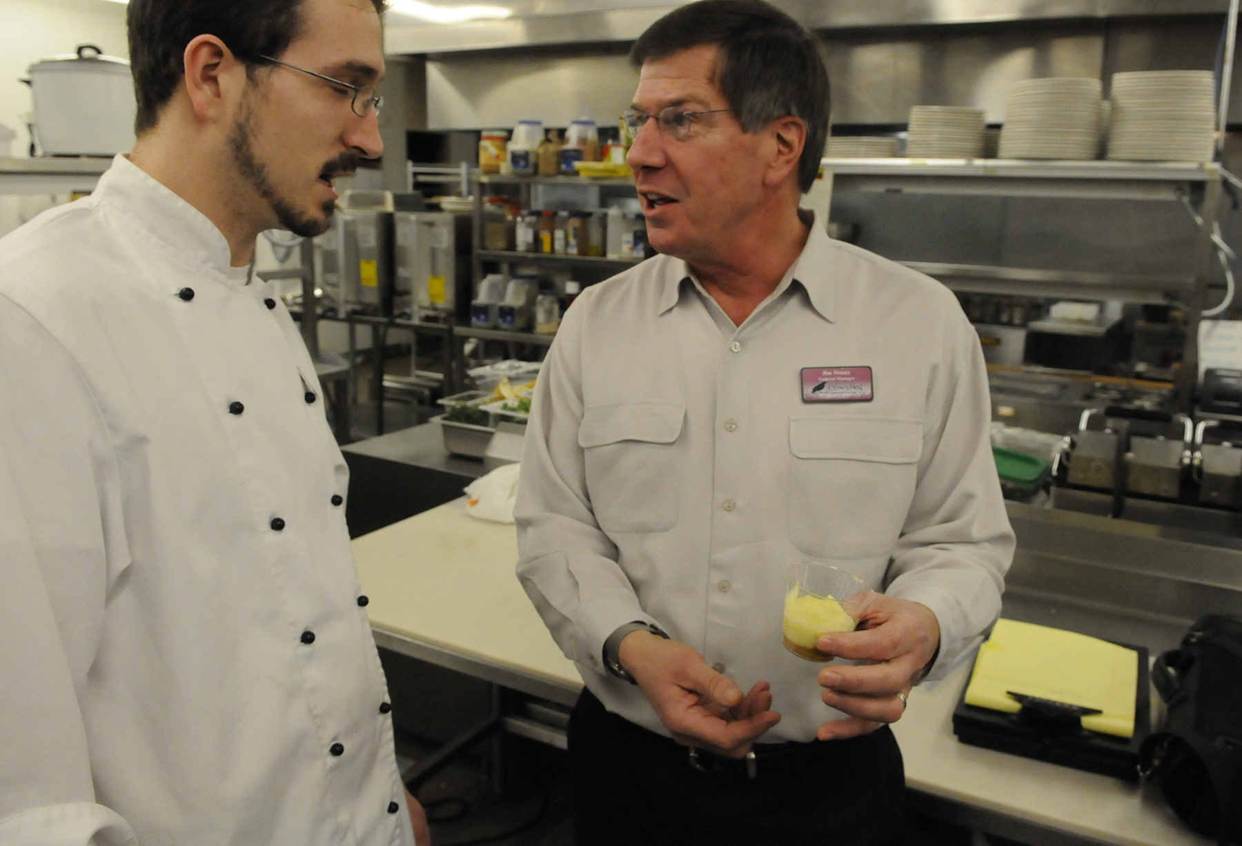 Jim Stacey, right, general manager of the Crow's Nest Restaurant and Event Center in Presque Isle,  confers with his executive chef,  Joseph Gervais, of Caribou in the restaurant's kitchen Wednesday afternoon, Jan. 26, 2011. With the World Cup Biathlon tour coming to Presque Isle February 4-6 and to Fort Kent February 10-13, area businesses like The Crow's Nest, many of which are working and volunteering at both venues, expect to benefit.