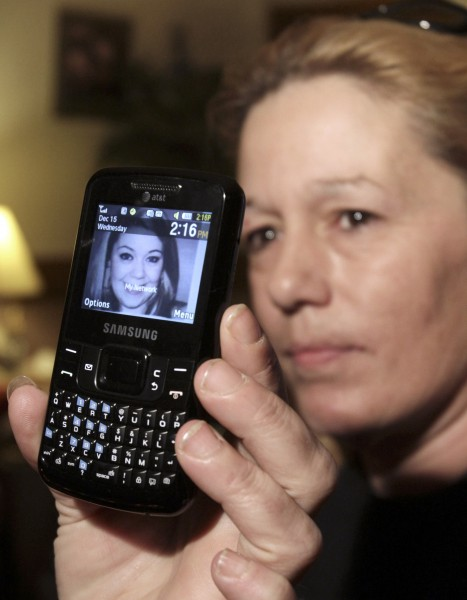Lorraine Ela of South Portland, Maine, displays her cell phone that has a picture of her daughter Megan Waterman, 22. Waterman was one of four women whose bodies were dumped along a desolate beachfront strip on Long Island.
