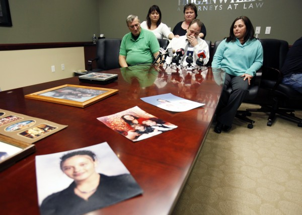 Family members Mark Szpila (front center), Elmer Barthelemy ( front left), Lynn Barthelemy (front right), Dawn Barthelemy (back left), and Susan Szpila (back center), speak about Melissa Barthelemy, pictured in family photographs on the desk, during a news conference in Amherst, N.Y.  Barthelemy was one of four women whose bodies were dumped along a desolate beachfront strip on Long Island. Authorities say all were prostitutes who booked their clients online and were probably slain by a serial killer.