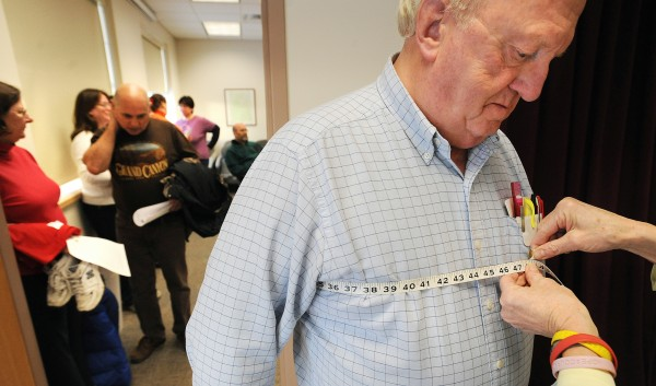 Gerry Wright is measured by Susan Nile as he was going through the process of signing up for the Biggest Winner weight loss competition at the Maine Central Institute in Pittsfield Friday.  Wright, 76, is the choral director and piano teacher at the school entered because he is hoping to loose 50 lbs.  &quotThis probably means I have to give up everything I like.&quot he said.  About 60 people registered for the competition that is originated at MCI, but is open to the public community.