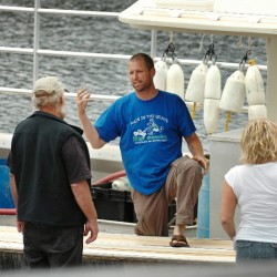 Phil Torrey (center), captain of the Master Simon, talks to Joe Sargent (from left), Spencer Joyce and Shauna Wheeler in July 2010 about the lobster boat collision he was involved in near Pond Island which left fellow Winter Harbor fisherman Frank Jordan, 71, dead and Jordan's boat, the Linda Diane, sunk.