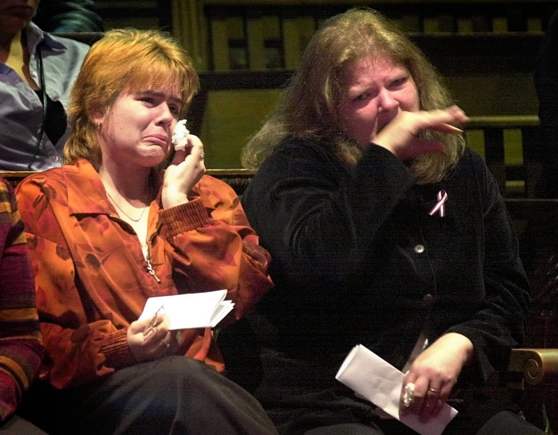 Christy Reposa (left) and Katlyn Badger, the biological mother and grandmother of 5-year-old Logan Marr, weep during the sentencing hearing nine years ago for Sally Ann Schofield in Kennebec County Superior Court in Augusta.
