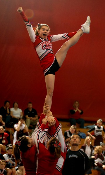 BANGOR, ME -- JANUARY 29, 2011 -- Hillary Williams performs a heel stretch during Central High School's performance at the 2011 Eastern Maine Regional Cheerleading Competition at the Bangor Auditorium Saturday Jan. 29, 2011.  Central took third place and will advance to the State Championship on Feb. 12, 2011.