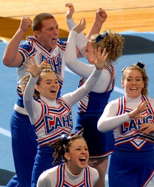 Kyle Donahue of Central Aroostook celebrates with teammates during the Eastern Maine Class D cheering finals Saturday at the Bangor Auditorium. CAHS won the title.
