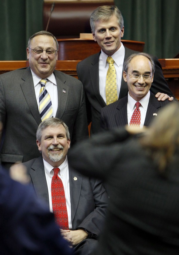 Gov. Paul LePage, top left, poses with Secretary of State Charles Summers, top center, Treasurer Bruce Poliquin, far right, and Attorney general Bill Schneider, Thursday at the State House in Augusta, Maine.