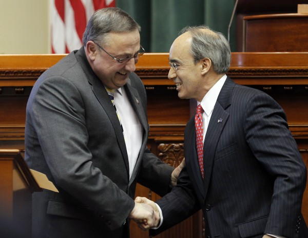 Gov. Paul LePage (left) congratulates Bruce Poliquin after Poliquin was sworn in as state treasurer Thursday, Jan. 6, 2011, at the State House in Augusta, Maine. LePage and Poliquin were rivals in the Republican gubernatorial primary.