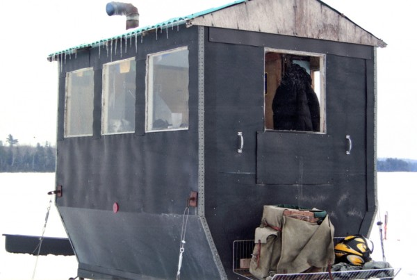 I have two shacks. This one, the larger, 4 by 8 at its base with cantilevered walls to increase room inside with an advantage of seating and storage. Wood heat and tempered glass windows, and painted black for heat gain from the sun. It has a through rod tie down system and seats 4-5. The larger shack is a Deadman's Rock on Schoodic Lake.