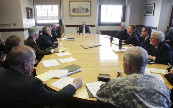 Gov . Paul LePage, background center, holds his first cabinet meeting with staff at the State House in Augusta, Maine on Monday, Jan. 10, 2011. (AP Photo/Pat Wellenbach)