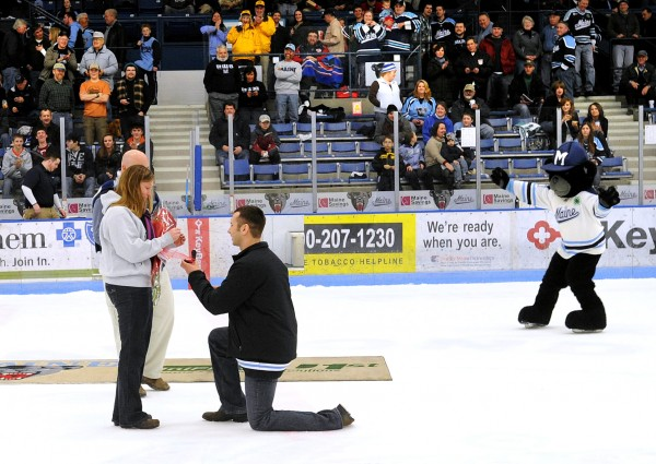 Chris Austin proposes to his girlfriend Heidi Choate on center ice of the Alfond Arena after the first period of the University of Maine versus Boston University hockey game.  Choate was under the impression that they were going to be presented with an prize that Austin won.  She said yes to the proposal as the hockey fans cheered and applauded them.